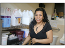 GRAMEEN AMERICA ENTREPRENEUR ELIZABETH WITH HER HAIR PRODUCTS