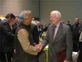 MUHAMMAD YUNUS AND FELLOW NOBEL LAUREATE, PRESIDENT JIMMY CARTER AT THE CHICAGO NOBEL PEACE SUMMIT, 2012