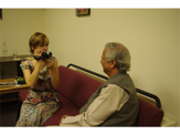 GAYLE FINDS A QUIET MOMENT TO INTERVIEW PROF. YUNUS BACKSTAGE AT TUFTS