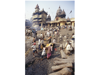 MANIKARNIKA, INDIA, BODY BEING BATHED IN GANGES RIVER BEFORE CREMATION